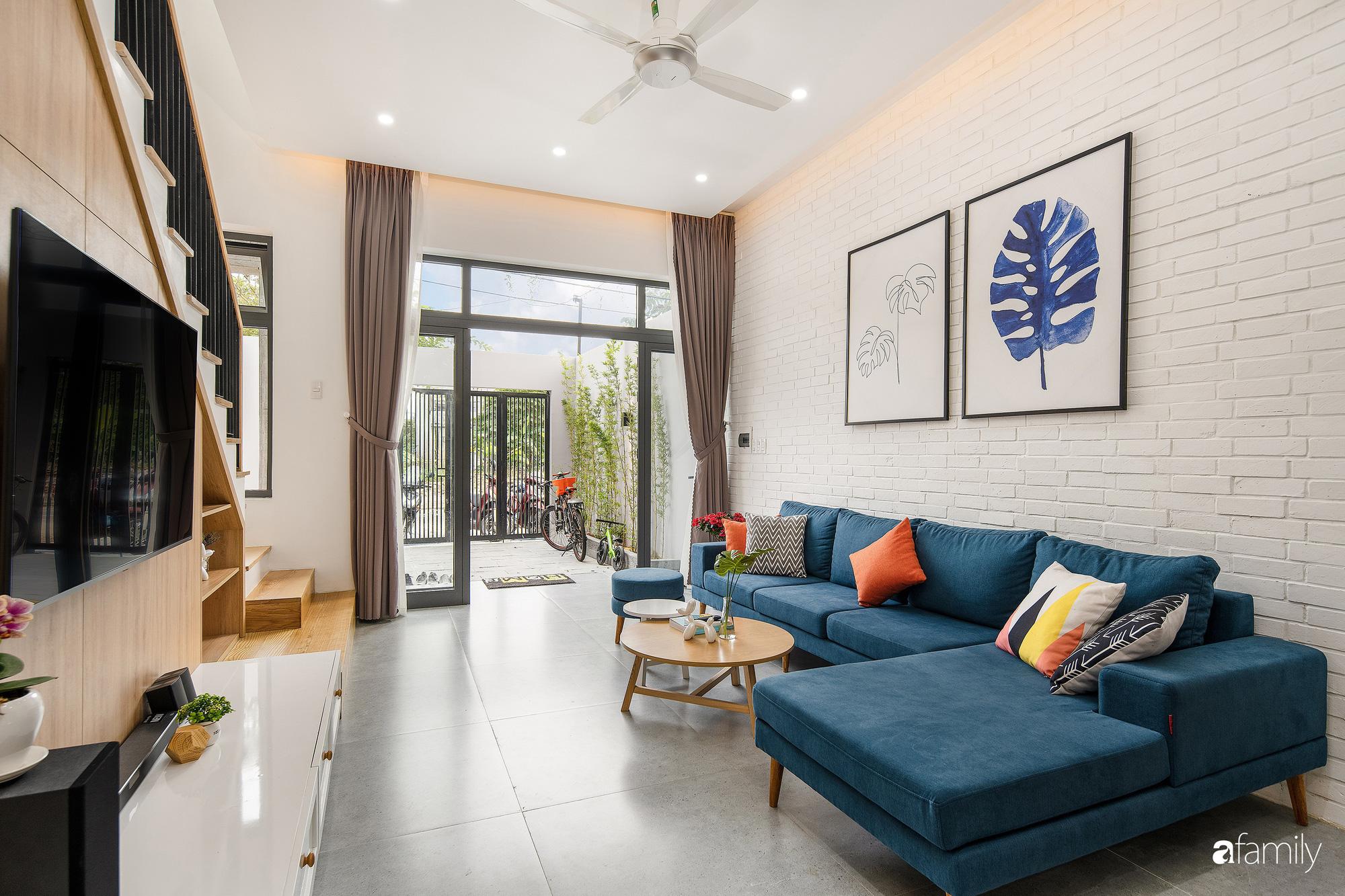 Nhà phố 2 tầng rộng 100m2 được thiết kế ấn tượng với khoảng thông tầng nhiều ánh sáng có chi phí 1,4 tỷ ở Đà Nẵng - Ảnh 5.