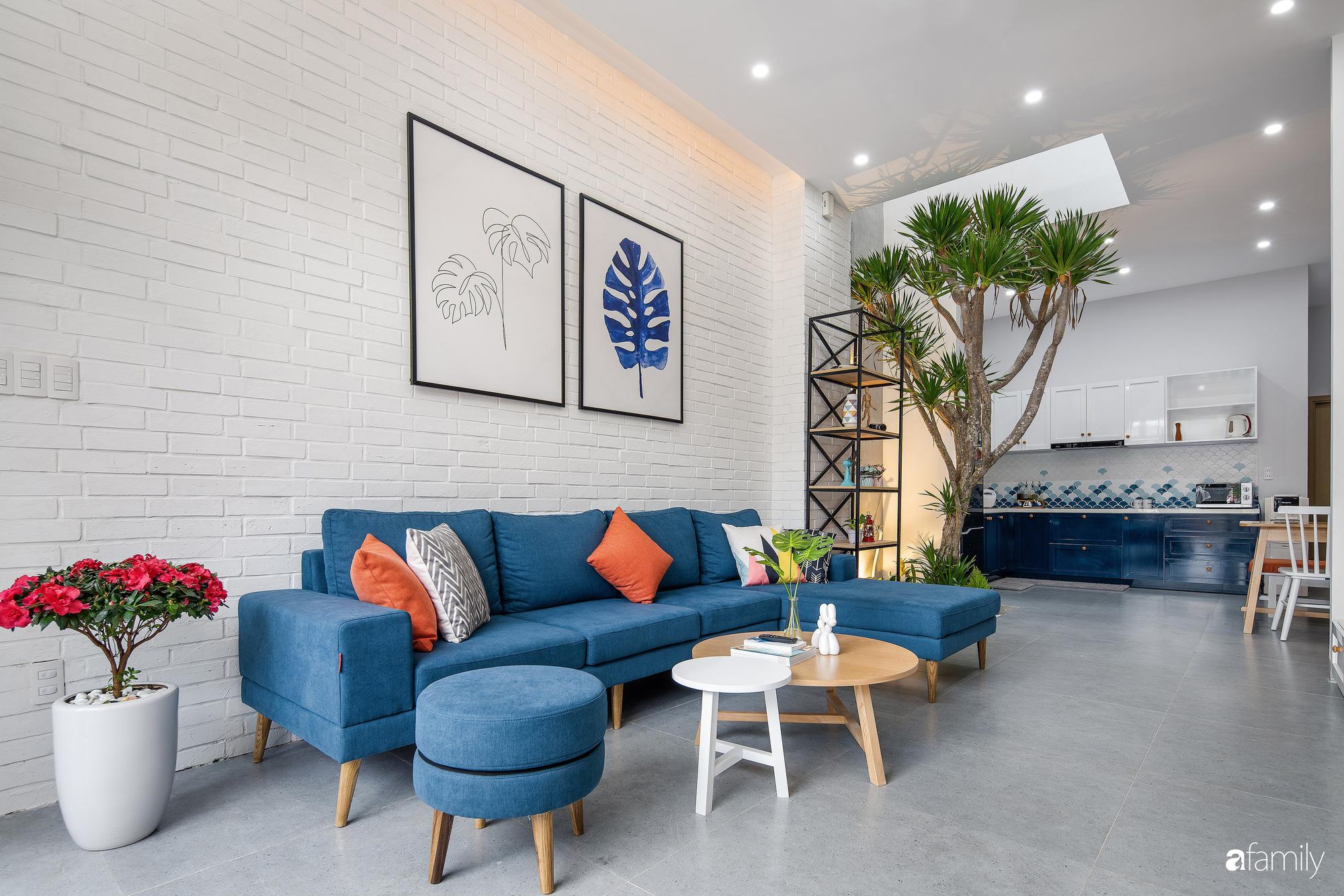 Nhà phố 2 tầng rộng 100m2 được thiết kế ấn tượng với khoảng thông tầng nhiều ánh sáng có chi phí 1,4 tỷ ở Đà Nẵng - Ảnh 4.