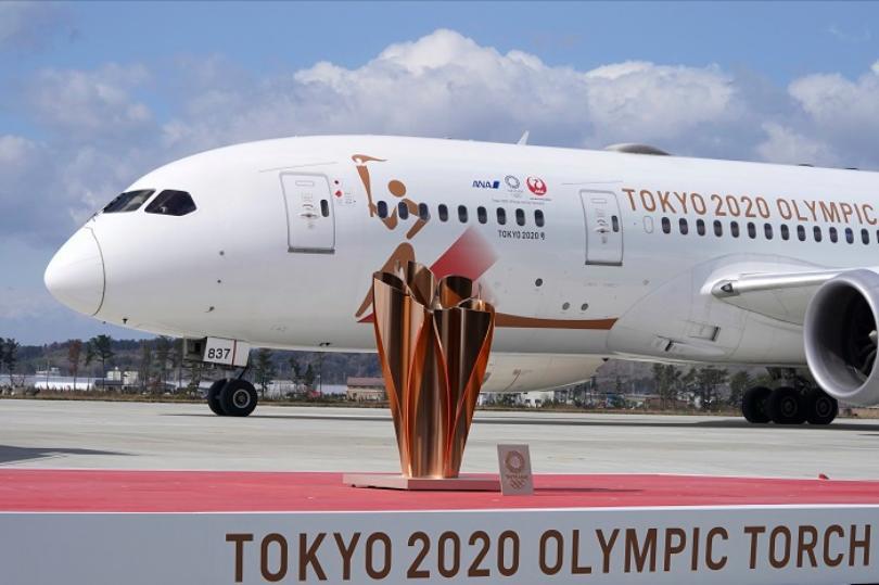 Đuốc Olympic 2020 lặng lẽ đến Nhật Bản giữa những hoài nghi và lo ngại vì dịch Covid-19 - Ảnh 1.