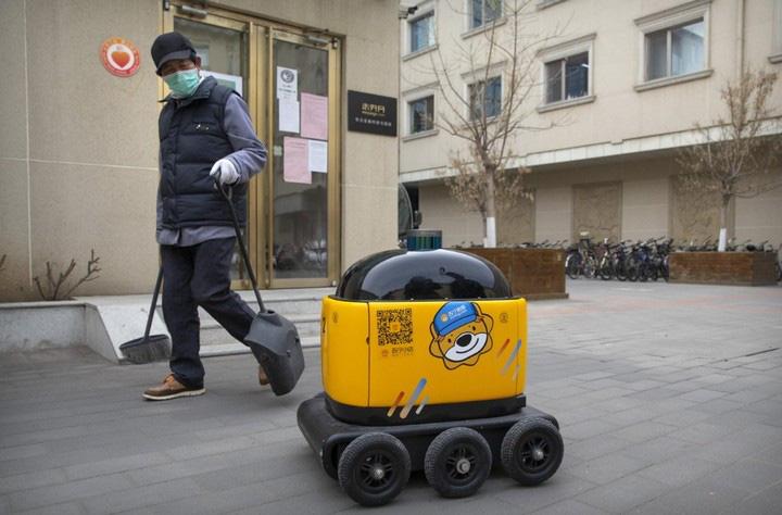 Robot chuyên phân phát rau, củ, quả và tuần tra cho thấy mức độ tự động hóa ngày càng cao của Trung Quốc - Ảnh 1.
