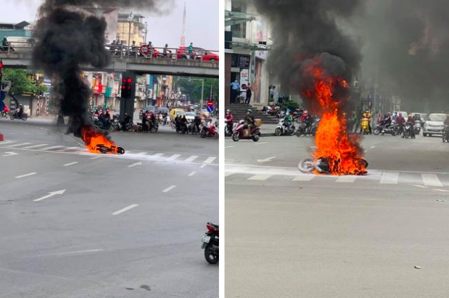 Chiếc xe máy bất ngờ cháy thành than giữa phố Hà Nội, hiện trường vụ việc khiến người xem đầy ám ảnh - Ảnh 1.