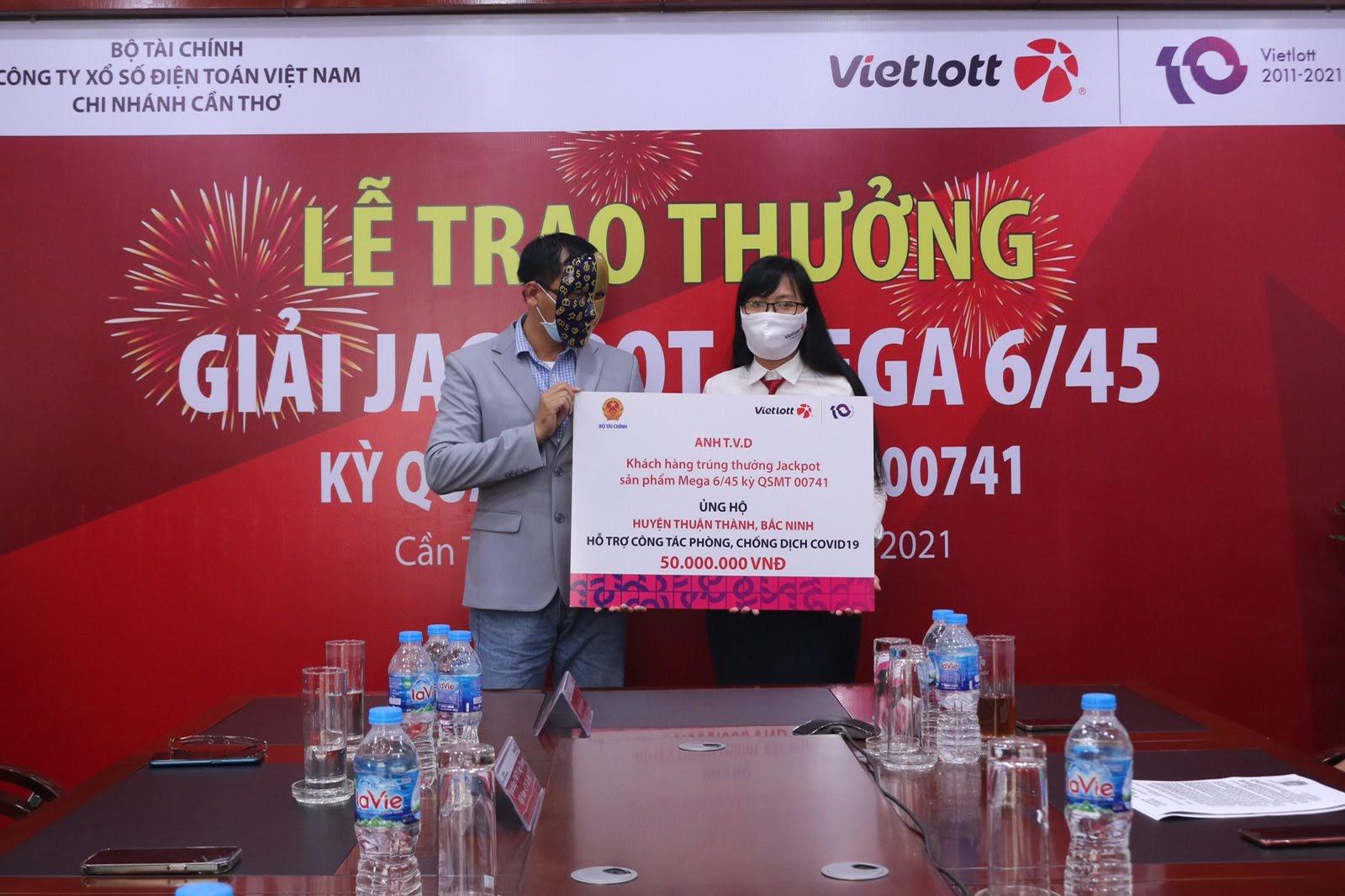 Vietlott chung tay ủng hộ quỹ Vắc-xin phòng Covid - 19 - Ảnh 4.