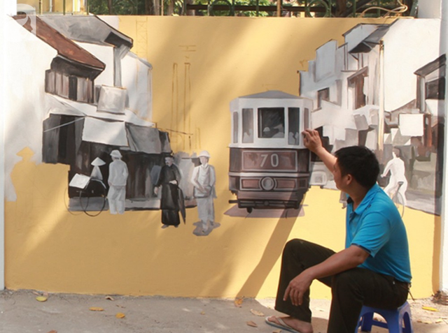 Hà Nội: Nhiều người ngỡ ngàng trước bức tường cũ kỹ trên phố Phan Đình Phùng được khoác áo mới - Ảnh 4.