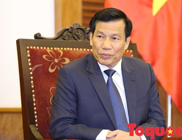 Bộ trưởng Nguyễn Ngọc Thiện động viên đội tuyển Việt Nam trước khi bước vào vòng bán kết AFF U22 Cup - Ảnh 1.