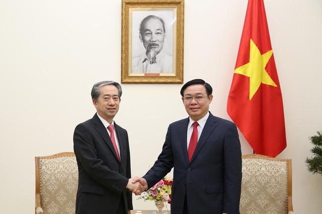Phó Thủ tướng Vương Đình Huệ tiếp Đại sứ Trung Quốc - Ảnh 1.