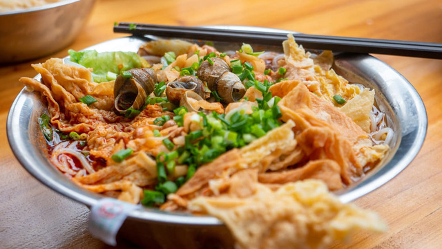 Phở ốc – Món ăn lạ thường nhưng cực khoái của người Trung Quốc - Ảnh 1.