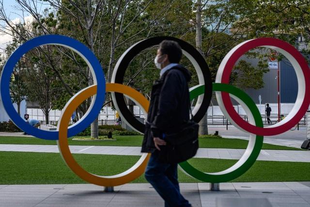 Quyết tâm tổ chức Olympics, Nhật Bản muốn chứng minh sức mạnh của nhân loại trước COVID-19 - Ảnh 1.