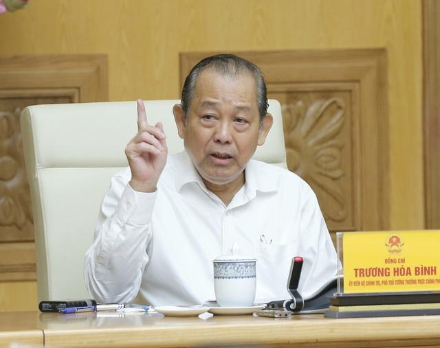 Phó Thủ tướng Trương Hòa Bình chủ trì họp sửa đổi 3 nghị định về cổ phần hóa, thoái vốn Nhà nước - Ảnh 1.