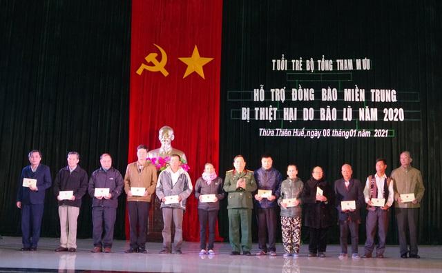 Bộ Tổng Tham mưu tặng quà, động viên gia đình các liệt sỹ ở thủy điện Rào Trăng 3 - Ảnh 1.
