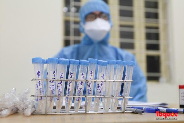 Hà Nội tiến hành xét nghiệm SARS-CoV-2 cho tân binh chuẩn bị nhập ngũ - Ảnh 11.