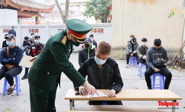 Hà Nội tiến hành xét nghiệm SARS-CoV-2 cho tân binh chuẩn bị nhập ngũ - Ảnh 5.