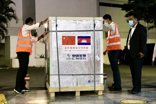 Trung Quốc thúc đẩy vai trò vaccine Covid-19 toàn cầu - Ảnh 1.