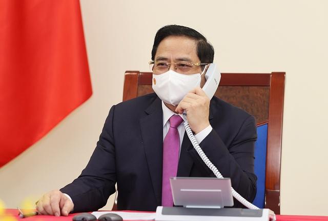 Nhật Bản sẽ hỗ trợ tối đa với Việt Nam bảo đảm vắc-xin Covid-19 - Ảnh 1.