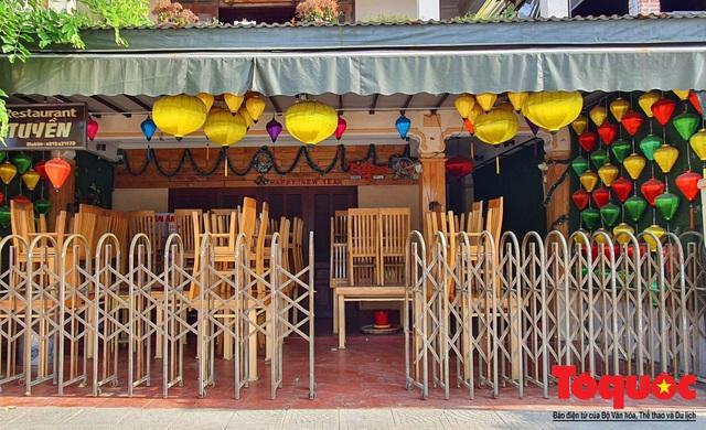 Nhiều hàng quán ở phố cổ Hội An vẫn chưa mở cửa dù đã được phép - Ảnh 6.