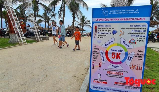 Từ 0 giờ ngày 9/6, Đà Nẵng cho tắm biển trở lại theo giờ; hàng quán được bán, phục vụ tại chỗ - Ảnh 2.