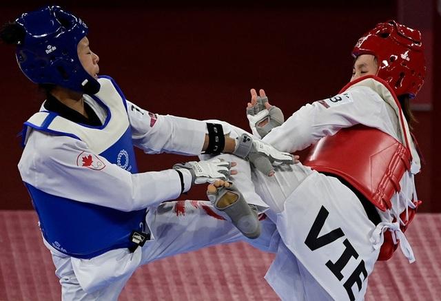Đánh bại võ sĩ người Canada, Trương Thị Kim Tuyền đưa Taekwondo vào Tứ kết đối đầu địch thủ người Thái Lan - Ảnh 1.