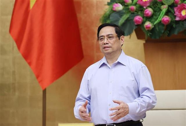 Thủ tướng Phạm Minh Chính: Cần có nhận thức và giải pháp mới trong chống dịch COVID-19 - Ảnh 1.