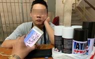 Du khách nước ngoài dùng sơn vẽ bậy lên tường ở phố đi bộ Bùi Viện