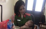 Hà Nội: Giải cứu thanh niên bế con gái 7 tháng tuổi ngồi vắt vẻo trên thành cầu Nhật Tân