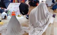 """Bé gái sợ người lạ, anh thợ ảnh nhanh trí kiếm tấm vải nhưng lại hành động khiến tất cả """"đứng hình"""""""