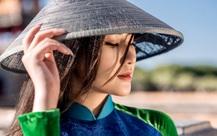 Mỹ nhân có mái tóc đẹp nhất Hoa hậu Việt Nam 2016 tái xuất với áo dài hoa sen
