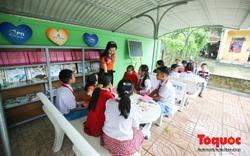 Học sinh tiểu học Kỳ Lâm thích thú với Thư viện xanh do Bảo hiểm PTI trao tặng