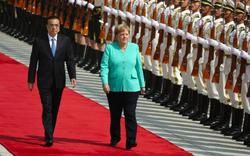 Đức lên tiếng về thương chiến Mỹ - Trung