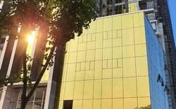 Phạt hai chủ đầu tư tòa nhà ốp kính vàng phản quang gây chói mắt