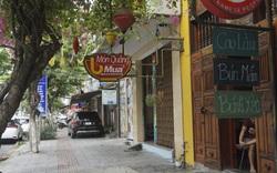 """Nhiều hàng quán ở vùng xanh vẫn """"đóng cửa then cài"""" dù được phép mở bán"""