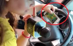 """""""Rúng động"""": Nữ tài xế lái xe 1 tay, vừa cầm điện thoại vừa cầm míc hát karaoke"""